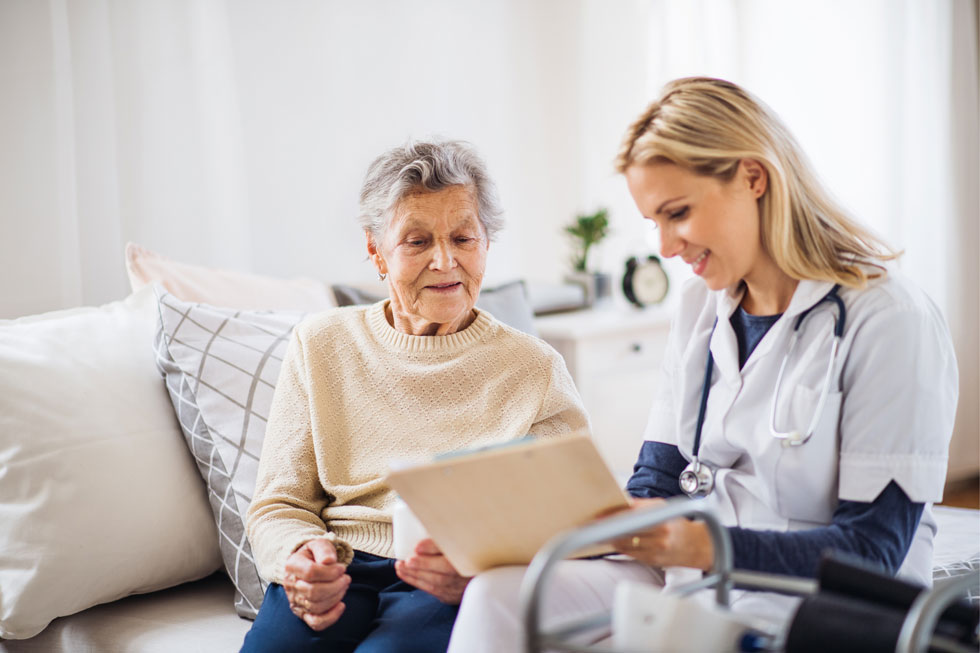 a doctor showing a patient her medical records