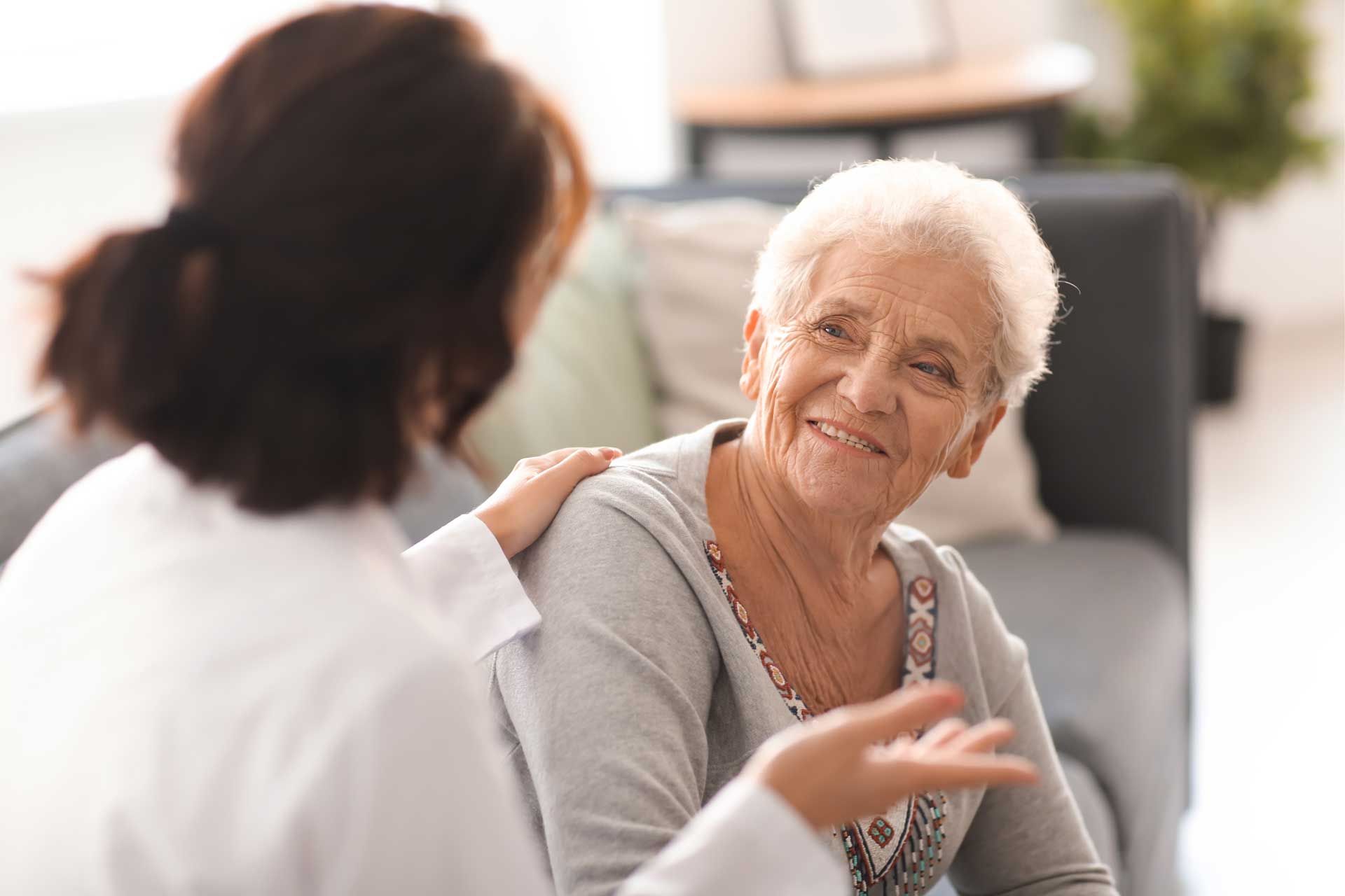 a doctor talking to an elderly patient